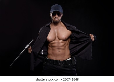 Conceptual photo of young, sexy and good looking police officer,