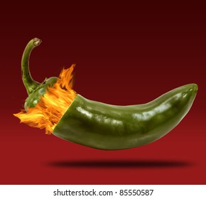 Conceptual photograph of a jalapeno exploding with fire