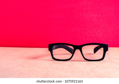 Conceptual photograph of life, spectacles with matte black frame