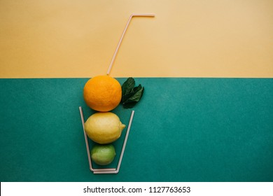 Conceptual photography. Citrus lemonade or juice from fresh fruits in a glass of tubes