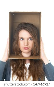 conceptual portrait of a woman's head hidden in a cardboard box