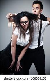 Conceptual portrait of a young fashionable couple