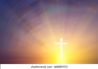 Conceptual religious composition in the form of a cross on a background of a blurry sunset with the rays of the sun. Abstract composition