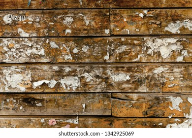 conceptual retro design of a wooden wall with scraps of paper ads, a specially created dilapidated surface in the photo, a very fashionable concept for luxury buildings