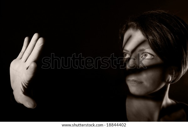 Conceptual Shot of an Attractive Woman Holding her Hand up to the Light
