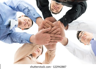 Conceptual shot of a dedicated business team joining hands