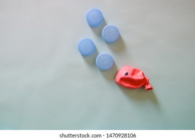 Conceptual still life photo showing concept of environmental issues, ocean pollution and raising awareness for environmental conservation in a fun, cute and colorful way