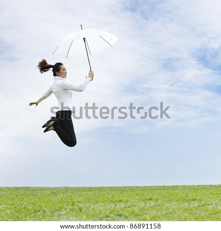 Conceptual Stock image of an Asian business woman jumping for joy