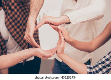 Conceptual symbol of cooperation diverse hands making a circle. People help each other