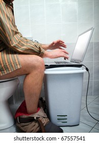 "Conceptual view of  an internet addict during ""calling of nature""  in the toilet."