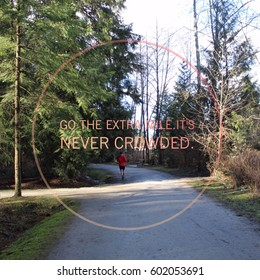 Conceptual view of park landscape in spring with person jogging on trail in background.  Inspirational quote.  Go the extra mile. It's never crowded.