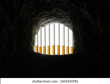 Conceptual view of smoking addiction (cigarette addiction), presenting cigarettes as the bars of a hard to escape prison/cave.