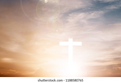 Conceptual wood cross or religion symbol shape over a sunset sky with clouds background for God. belief or resurrection of god and worship christian. sky freedom.