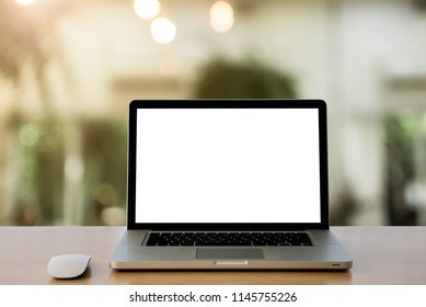 Conceptual workspace,Empty space Wooden Desk with on Laptop screen and wireless mouse,Interior Cafe blurred background at light bokeh.