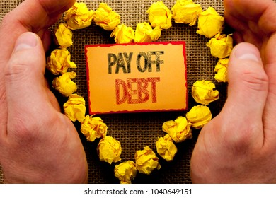 Conceptual writing showing Pay Off Debt. Business photo showcasing Reminder To Paying Owed Financial Credit Loan Bills written Sticky Note Paper With Heart Holding Hand with Finger