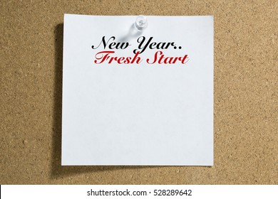 Conceptual,notebook on a white table. open diary and pen New Year.. Fresh Start words