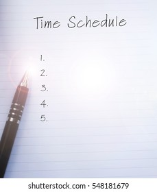 Conceptual,notebook on a white table. open diary and pen with TIME SCHEDULE words. Copy space.