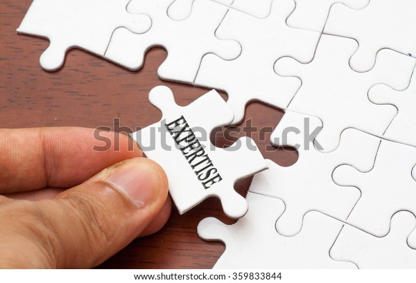 conceptual,Placing missing a piece of puzzle with expertise word
