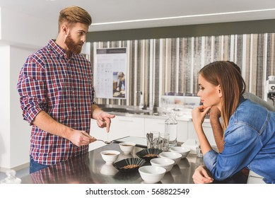 Concerned bearded man with coffee