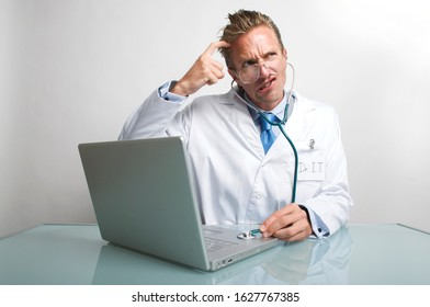 Concerned IT computer technician scratching his head listening to a laptop with his stethoscope