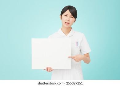 concerned Japanese nurse with Bulletin Board