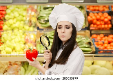 Concerned  Lady Chef Inspecting Vegetables with Magnifying Glass - Portrait of a young female cook in a grocery store checking for best quality ingredients