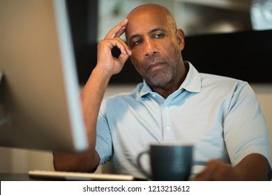 Concerned man sitting at his computer.
