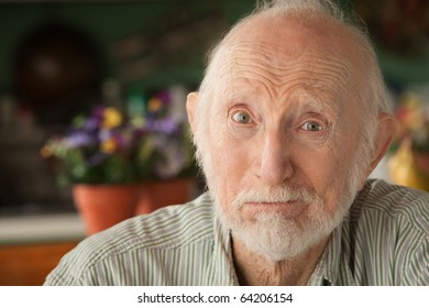 Concerned senior man at home in his house
