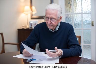 Concerned Senior Man Reviewing Domestic Finances