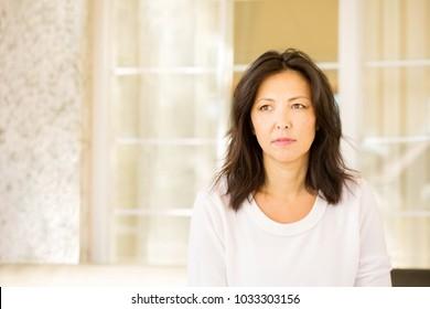 Concerned woman looking worried.