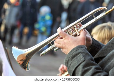 Concert brass band music - close up musician with trombone on an public event, selective focus