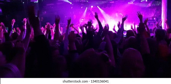 Concert crowd, bright lights in front