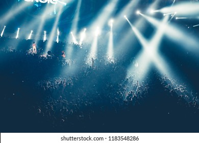 Concert crowd and lights grained background