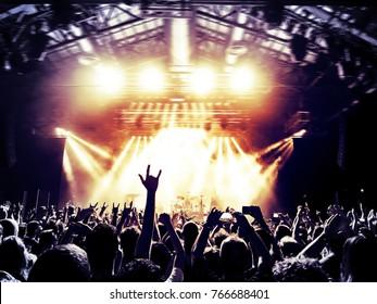 Concert fans raising horn signs