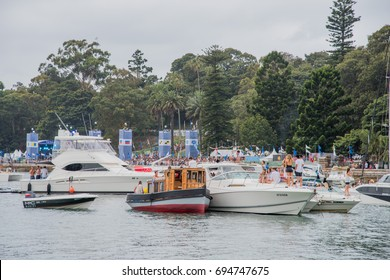 Concert goers, yachts and The Plot stage in Sydney, Australia/The Plot Stage and Spectators/SYDNEY,NSW,AUSTRALIA-NOVEMBER 19,2016: The Plot concert stage, park, yachts and people in Sydney, Australia