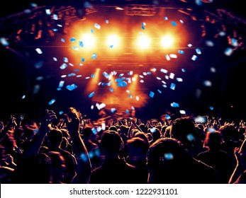 Concert hall with clapping crowd people