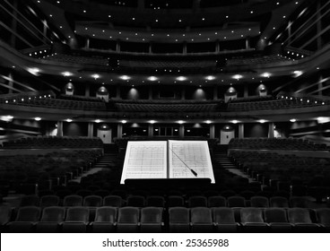 Concert hall with conductor stand, notes and baton