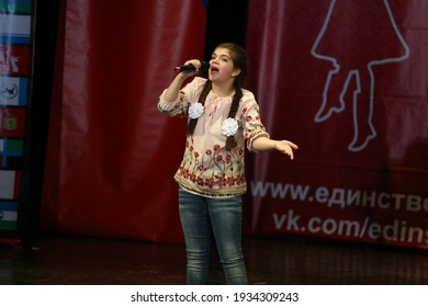 """Concert Hall """"Cosmos"""", Moscow, Russia - 11.17.2018: International competition-festival of creative teams """"Energy of Creativity"""" and """"Steps of Mastery"""". Beautiful girl sings on stage."""