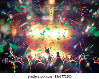 Concert hall with crowd clapping