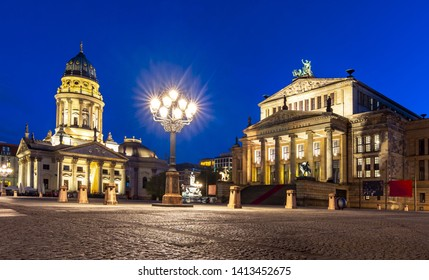 Concert Hall (Konzerthaus) and New Church (Deutscher Dom or Neue Kirche) on Gendarmenmarkt square at night in Berlin, Germany