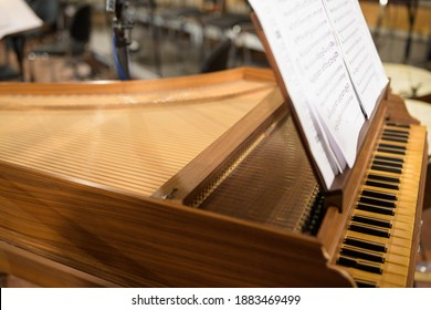 Concert harpsichord with music notes