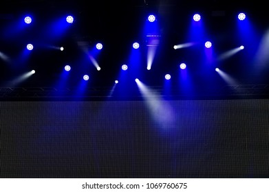 concert lighting of a free scene. Stage lights on a dark background.