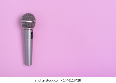 Concert microphone on a beautiful purple background.