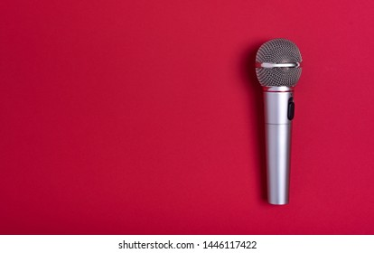 Concert microphone on a beautiful red background.