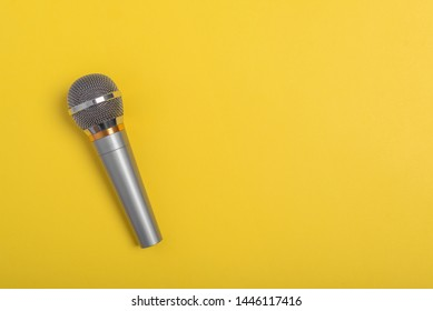 Concert microphone on a beautiful yellow background.