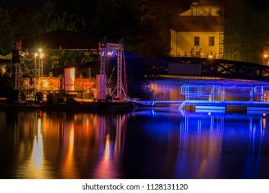 Concert Muzy na vode, podium on Malse river, long exposure - Shutterstock ID 1128131120