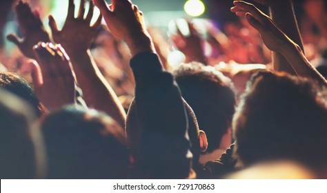 Concert People with Hands Up Excited Attendees Listening to Live Music