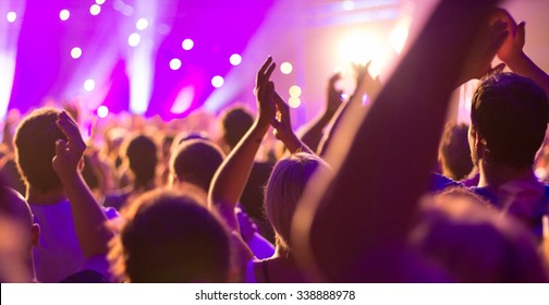 A concert, people are happy, celebrating and have fun at the great music, they applaud