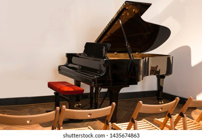 concert piano in front of chairs