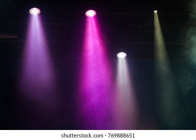 Concert stage. Beautiful Colorful disco lighting in the stage. Performance moving lighting. Concert Light Show. Stage Lights.